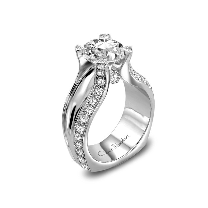 CLAUDE THIBAUDEAURing - CLAUDE THIBAUDEAU White 18 Karat Contemporary Ring Size 7 56=0.42tw Round G/H VS1 Diamonds 4=0.02tw Round G/H VS1 Diamonds 2=0.10tw Round G/H VS1 Diamonds Gold GM Wt: 11.4 (Center Stone Not Included)