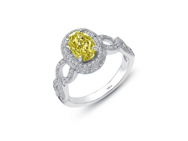Ring - Lady's White Sterling Silver  Bonded With Platinum Halo Ring With One 9.00X6.00Mm  Canary Yellow Oval Simulated Diamond And 94=2.35Tw Round Simulated Diamonds Tw includes Center Stone. Size 7